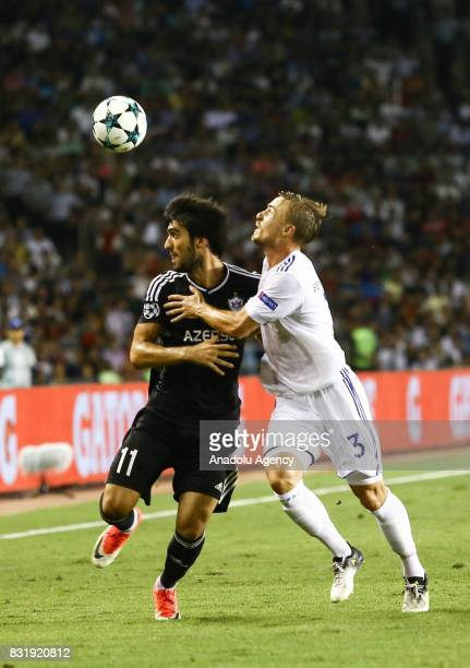 Mahir Madatov of Qarabag Agdam in action against Pierre Bengtsson of FC Copenhagen during the UEFA Champions League playoff match between Qarabag...