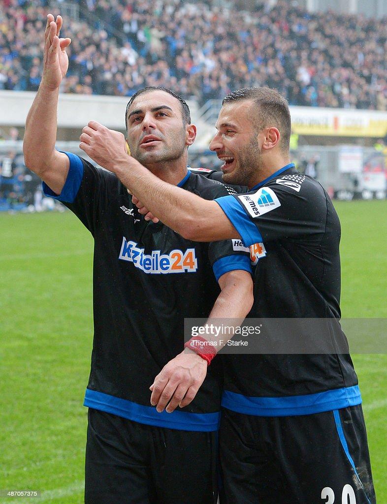 Mahir Saglik (L) and Sueleyman Koc of Paderborn cebrate their teams second goal during the Second Bundesliga match between SC Paderborn and SV Sandhausen at Benteler Arena on April 27, 2014 in Paderborn, Germany.