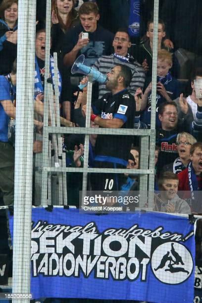 Mahir Saglik of Paderborn celebrates with the fans after winning the Second Bundesliga match between SC Paderborn and FSV Frankfurt at Benteler Arena...