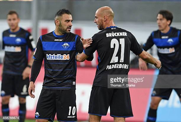 Mahir Saglik of Paderborn chats with Daniel Brueckner of Paderborn during the Bundesliga match between SC Paderborn and Hertha BSC at Benteler Arena...