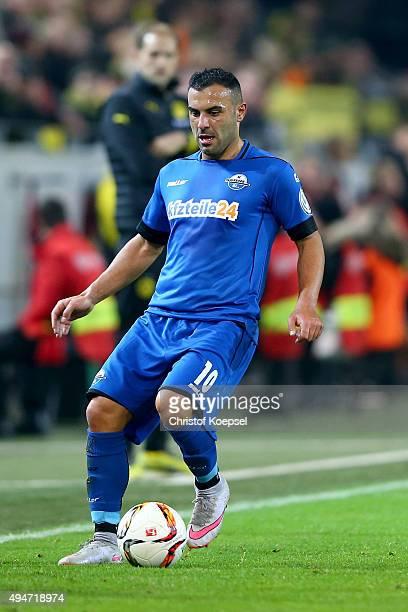 Mahir Saglik of Paderborn runs with the ball during the DFB Cup match between Borussia Dortmund and SC Paderborn at Signal Iduna Park on October 28...