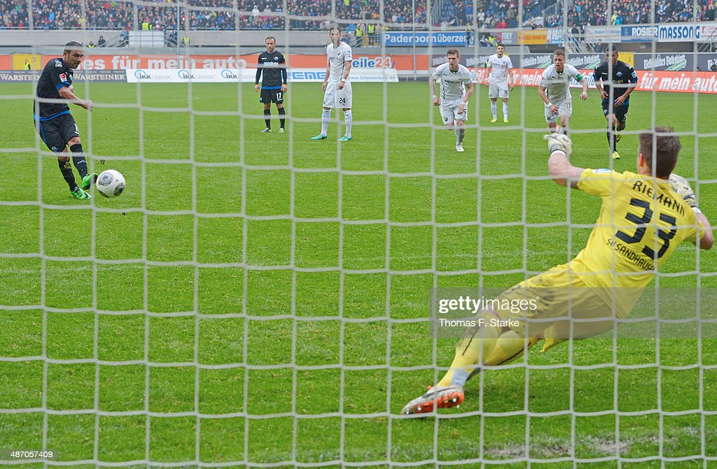 Mahir Saglik (L) of Paderborn scores a penalty against goalkeeper Manuel Riemann of Sandhausen during the Second Bundesliga match between SC Paderborn and SV Sandhausen at Benteler Arena on April 27, 2014 in Paderborn, Germany.