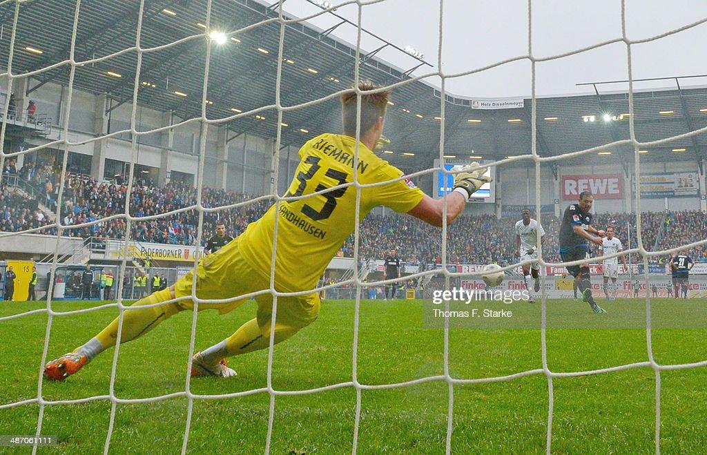 Mahir Saglik (R) of Paderborn scores a penalty against goalkeeper Manuel Riemann of Sandhausen during the Second Bundesliga match between SC Paderborn and SV Sandhausen at Benteler Arena on April 27, 2014 in Paderborn, Germany.