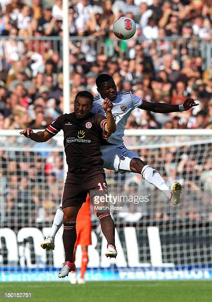 Mahir Saglik of St Pauli and Alex Ikeng of Ingolstadt head for the ball during the Second Bundesliga match between St Pauli and FC Ingolstadt at the...