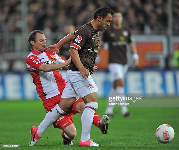 Mahir Saglik of St Pauli is challenged by Patrick Kohlmann of Berlin during the second Bundesliga match between FC St Pauli and 1 FC Union Berlin at...