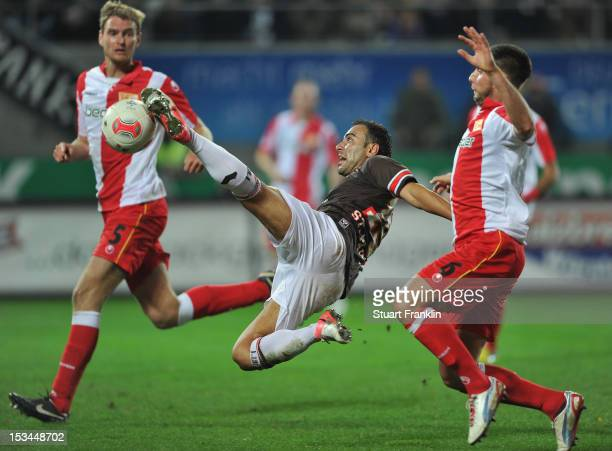Mahir Saglik of St Pauli is challenged byMarc Pfertzel of Berlin during the second Bundesliga match between FC St Pauli and 1 FC Union Berlin at...