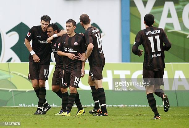 Mahir Saglik of St Pauli jubilates with team mates after scoring the fourth goal during the Second Bundesliga match between FC Hansa Rostock and FC...