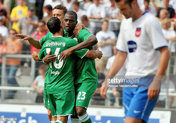 Mahir Saglik of Wolfsburg hugs Grafite during the DFB Cup first leg match between 1 FC Heidenheim and VfL Wolfsburg at the Albstadium on August 10...
