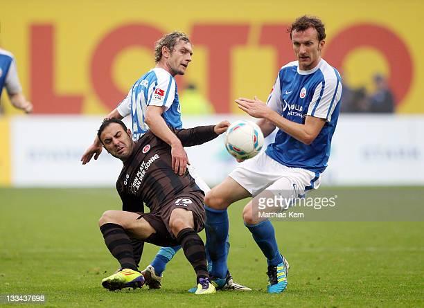 Mahir Saglik Peter Schyrba and Dominic Peitz battle for the ball during the Second Bundesliga match between FC Hansa Rostock and FC St Pauli at DKB...
