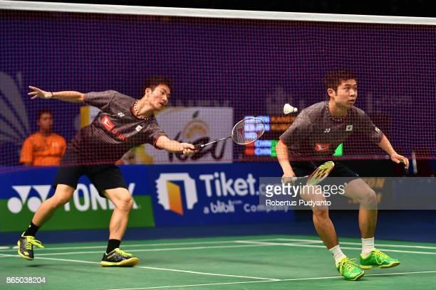 Mahiro Kaneko and Yunosuke Kubota of Japan compete against Di Zijian and Wang Chang of China during Men's Doubles Final match of the BWF World Junior...