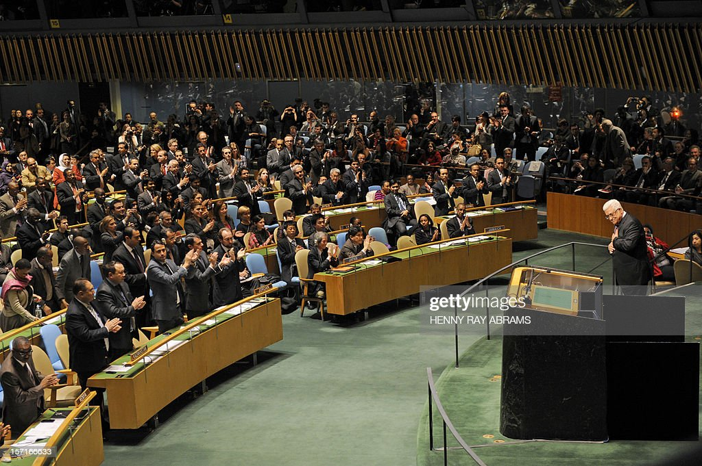 Mahmoud Abbas, President of the Palestinian Authority, gets a partial standing ovation after addressing the United Nations General Assembly before the body votes on a resolution to upgrade the status of the Palestinian Authority to a nonmember observer state November 29, 2012 at UN headquarters in New York. AFP PHOTO/Henny Ray Abrams