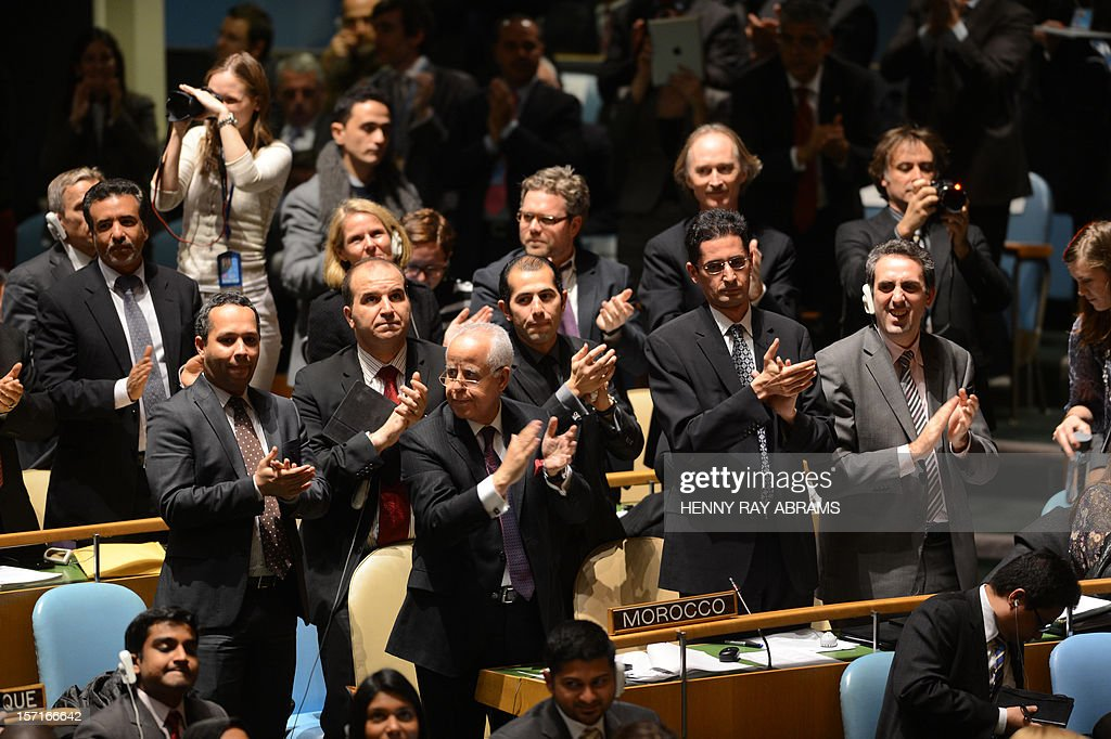 Mahmoud Abbas, President of the Palestinian Authority, gets a standing ovation from the Moroccan delegation before speaking to the United Nations General Assembly before the body votes on a resolution to upgrade the status of the Palestinian Authority to a nonmember observer state November 29, 2012 at UN headquarters in New York. AFP PHOTO/Henny Ray Abrams