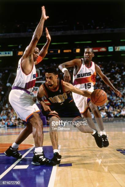 Mahmoud Abdul Rauf of the Denver Nuggets dribbles against the Phoenix Suns circa 1995 at McNicholls Arena in Denver Colorado NOTE TO USER User...