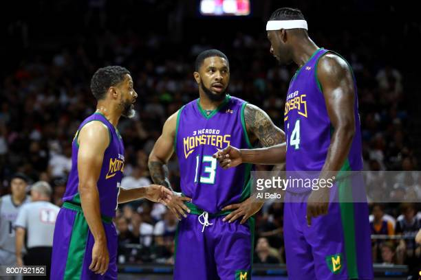 Mahmoud AbdulRauf Eddie Basden and Kwame Brown of the 3 Headed Monsters speak in the game against the Ghost Ballers during week one of the BIG3 three...