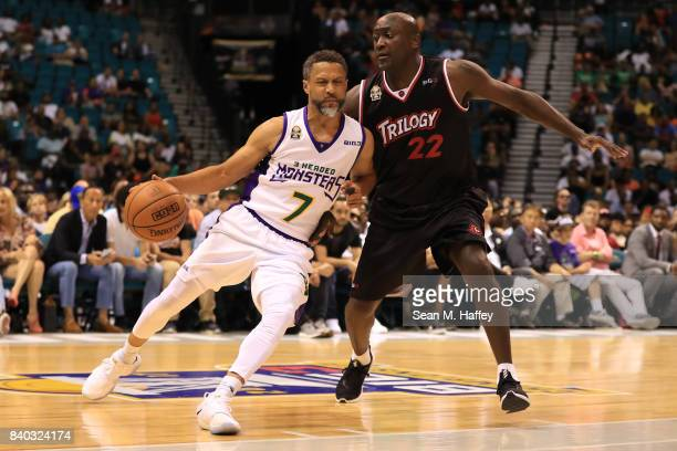 Mahmoud AbdulRauf of 3 Headed Monsters and Dion Glover of Trilogy during the BIG3 three on three basketball league championship game on August 26...