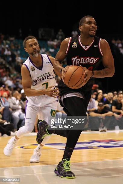 Mahmoud AbdulRauf of 3 Headed Monsters and James White of Trilogy during the BIG3 three on three basketball league championship game on August 26...