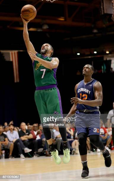Mahmoud AbdulRauf of the 3 Headed Monsters attempts a shot past Al Thornton of 3s Company during week five of the BIG3 three on three basketball...
