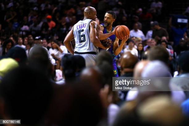 Mahmoud AbdulRauf of the 3 Headed Monsters handles the ball against Mo Evans of the Ghost Ballers during week one of the BIG3 three on three...