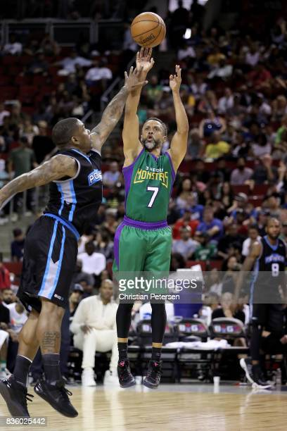 Mahmoud AbdulRauf of the 3 Headed Monsters shoots the ball in front of Paul McPherson of the Power in week nine of the BIG3 threeonthree basketball...