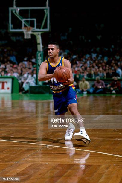 Mahmoud AbdulRauf of the Denver Nuggets drives against the Boston Celtics during a game played in 1992 at the Boston Garden in Boston Massachusetts...