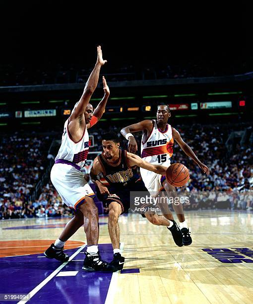 Mahmoud AbdulRauf of the Denver Nuggets drives to the basket against the Phoenix Suns during an NBA game at the America West Arena on October 13 1994...