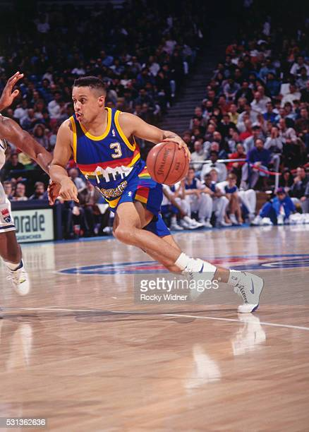 Mahmoud AbdulRauf of the Denver Nuggets drives to the basket during a game against the Sacramento Kings circa 1993 at Arco Arena in Sacramento...