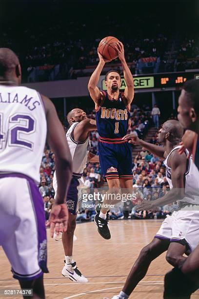 Mahmoud AbdulRauf of the Denver Nuggets shoots against the Sacramento Kings circa 1995 at Arco Arena in Sacramento California NOTE TO USER User...