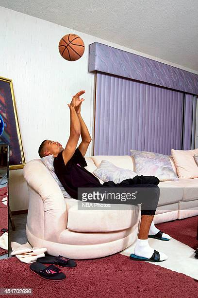 Mahmoud AbdulRauf of the Denver Nuggets sits on his sofa circa 1995 in Denver Colorado NOTE TO USER User expressly acknowledges and agrees that by...