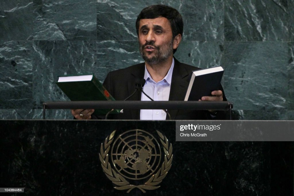Mahmoud Ahmadinejad President of the Islamic Republic of Iran holds up a Qur'an and a Bible during his address at the 65th session of the General...