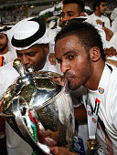 Mahmoud Ahmed Mohamed Hassan Alhamadi of Al Nasr team leads celebrations after winning the President's Cup Final in a penalty shoot out between Al...