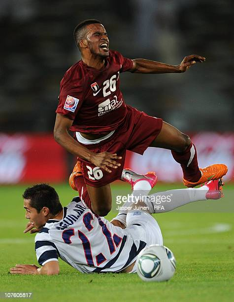 Mahmoud al Hammadi of AlWahda Sports Club is fouled by Paul Aguilar of Club de Futbol Pachuca during the FIFA Club World Cup match for fifth place...