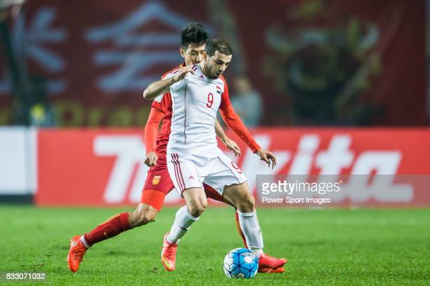Mahmoud Al Mawas of Syria battles for the ball with Yu Hai of China PR during their 2018 FIFA World Cup Russia Final Qualification Round Group A...