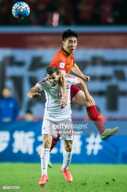 Mahmoud Al Mawas of Syria fights for the ball with Ren Hang of China PR during their 2018 FIFA World Cup Russia Final Qualification Round Group A...