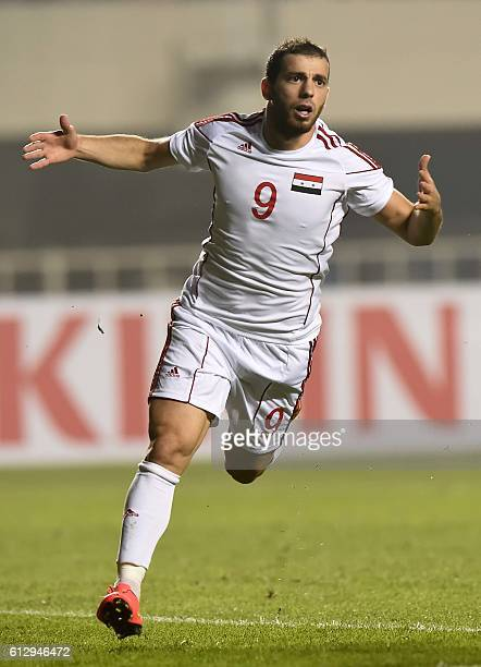 Mahmoud Almawas of Syria celebrates after he scored a goal during the 2018 World Cup qualifying group A match between Syria and China at Shanxi...
