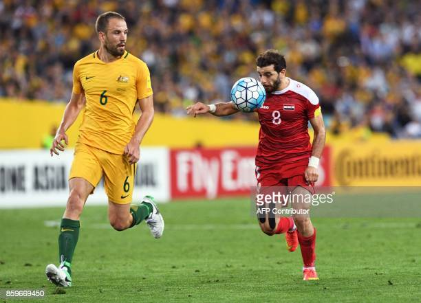Mahmoud Almawas of Syria is tackled by Matthew Jurman of Australia during their 2018 World Cup football qualifying match played in Sydney on October...
