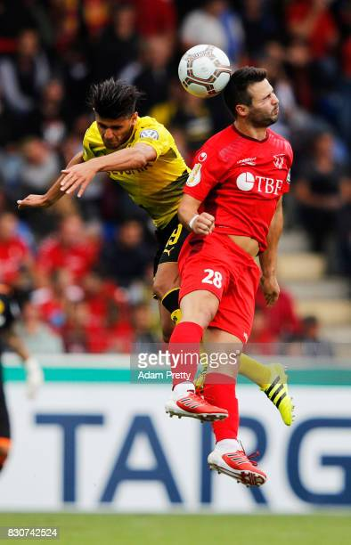 Mahmoud Dahoud of Borussia Dortmund challenges Frank Stark of FC RielasingenArlen during the DFB Cup match between 1 FC RielasingenArlen and Borussia...
