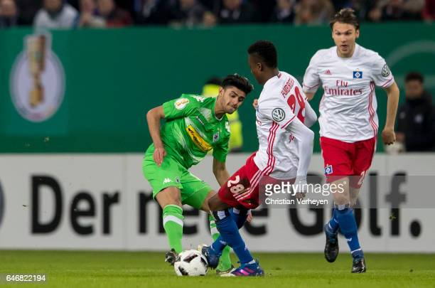 Mahmoud Dahoud of Borussia Moenchengladbach and Gideon Jung of Hamburger SV battle for the ball during the DFB Cup match between Hamburger SV and...
