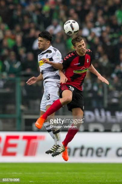 Mahmoud Dahoud of Borussia Moenchengladbach and Janik Haberer of SC Freiburg during the Bundesliga Match between Borussia Moenchengladbach and SC...