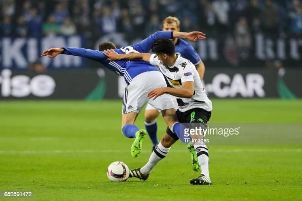 Mahmoud Dahoud of Borussia Moenchengladbach and Leon Goretzka of Schalke battle for the ball during the UEFA Europa League Round of 16 first leg...
