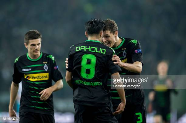 Mahmoud Dahoud of Borussia Moenchengladbach celebrate his team mate Andreas Christensen after he scores his teams second goal during the UEFA Europa...