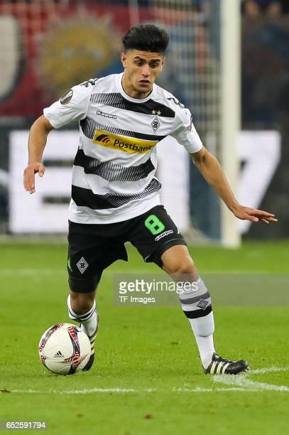 Mahmoud Dahoud of Borussia Moenchengladbach controls the ball during the UEFA Europa League Round of 16 first leg match between FC Schalke 04 and...