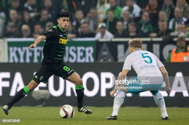 Mahmoud Dahoud of Borussia Moenchengladbach is chased by Johannes Geis of FC Schalke 04 during the UEFA Europa League match between Borussia...