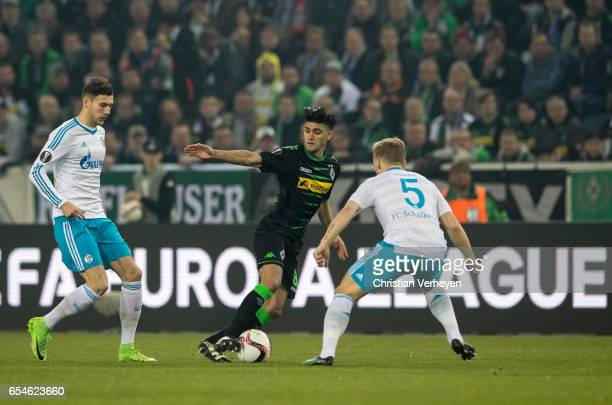 Mahmoud Dahoud of Borussia Moenchengladbach is chased by Leon Goretzka and Johannes Geis of FC Schalke 04 during the UEFA Europa League match between...