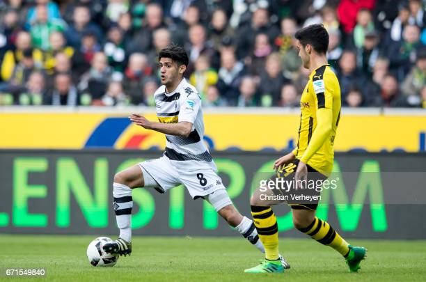 Mahmoud Dahoud of Borussia Moenchengladbach is chased by Mikel Merino of Borussia Dortmund during the Bundesliga Match between Borussia...