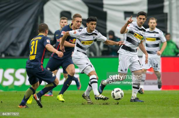Mahmoud Dahoud of Borussia Moenchengladbach is chased by Stefan Ilsanker and Diego Demme of RB Leipzig during the Bundesliga Match between Borussia...