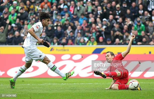 Mahmoud Dahoud of Borussia Moenchengladbach scores his team's first goal during the Bundesliga match between Borussia Moenchengladbach and 1 FC Koeln...