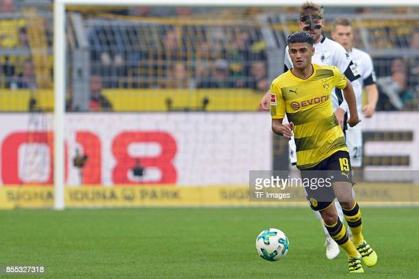 Mahmoud Dahoud of Dortmund and Christoph Kramer of Moenchengladbach controls the ball during the Bundesliga match between Borussia Dortmund and...
