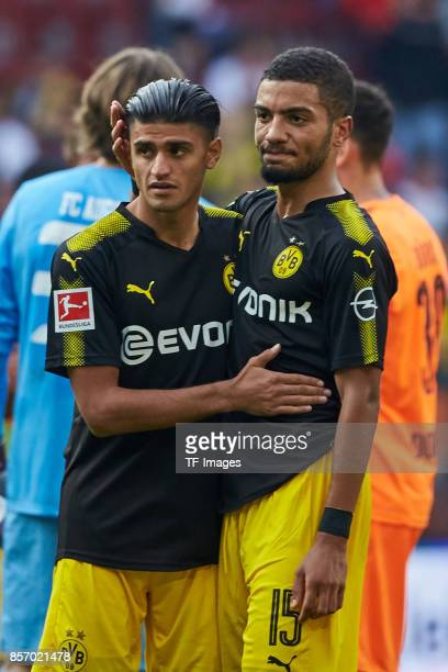 Mahmoud Dahoud of Dortmund and Jeremy Toljan of Dortmund looks on during the Bundesliga match between FC Augsburg and Borussia Dortmund at WWKArena...