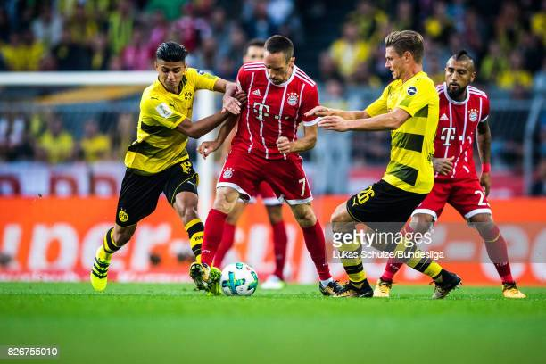 Mahmoud Dahoud of Dortmund Franck Ribery of Munich and Lukas Piszczek of Dortmund fight for the ball during the DFL Supercup 2017 match between...
