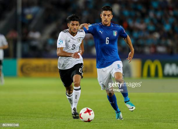 Mahmoud Dahoud of Germany and Lorenzo Pellegrini of Italy battle for the ball during the UEFA U21 championship match between Italy and Germany at...